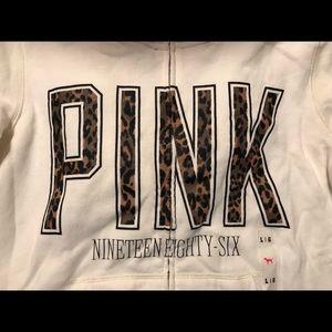 Cream colored VS pink hoodie with cheetah print